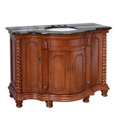 Besides it's curved front and unique hand carved design on columns and doors, this bathroom vanity has a rich traditional flavor that will not be disappointed. The cabinet is construction with solid b