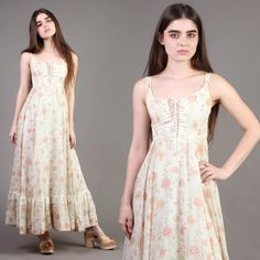 Corset rope tie doesn't look original. Gorgeous 1970s Gunne Sax dress! Victorian motif. Buttercream color with a muted floral print. Corset style bodice with lace-up ties. Sleeveless cut with thin shoulder straps. | eBay!