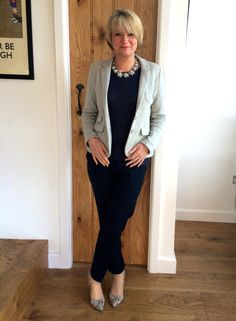 Soft light grey lifts navy and note by wearing grey print shoes with grey jacket the eye drawn from top to toe which elongates the silhouette