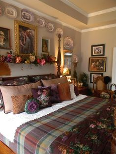"Nancy Roberts of Nancy's Daily Dish - ""Some of my purple transferware collection over our bed"""