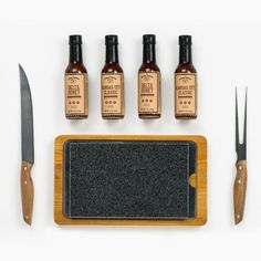 Steakhouse - A Steak Lover's Gift Set  Steak gift sets bring the steakhouse experience to you. This one includes a restaurant-quality lava stone, plus a carving knife and fork set, dipping bowls, and two delicious gourmet bbq sauces.