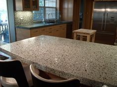 This is another concrete counter, though the addition of glass aggregate gives it the appearance of terrazzo. Because all concrete counters are one-of-a-kind, adding different colored glass or stone to the mix while it's being made can be just the thing if there are specific colors you'd like to integrate into a design.