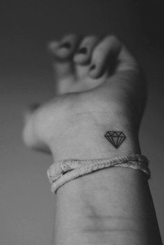 I would like to have a small diamond tattoo. It´d be a twintattoo, because my twinsister just had her first tattoo and it is a diamond.