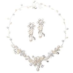 FOREVER YOURS - SHOEDAZZLE Polished, with an elegant mix of Swarovski crystals and freshwater pearls, this floral-motif duet signifies that your love is in full bloom.    FOR THE BRIDE WHO loves full bouquets of Hydrangeas.     BEAUTY TIP: A side-swept, curled ponytail shadows this set's softness.     ACCESSORIZE with a formal champagne-hued, bejeweled envelope clutch.