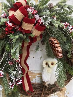 Christmas Wreath, Holiday Wreath, Owl Wreath, Etsy Wreath, Christmas Gift  This warm and inviting Christmas wreath is filled with beautiful quality greens and evergreen boughs, pine cones, frosted red berries a burlap and red velvet bow and finished with a lovely white owl.  The finished size from tip to tip is 24 x 22 x 9.  Thank you for visiting my shop!  To view all my items visit: https://www.etsy.com/shop/FlowerPowerOhio?ref=hdr_shop_menu