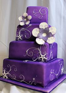 purple square scroll wedding cake.flowers look dumb, but could be cool with real fuscia colored flowers