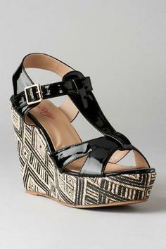 ...but as she buckles her Embla Printed Wedge, she glances at the clock and realizes she's running late!...