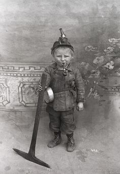 Eight year old coal miner, USA, early 1900's. My grandparents had to quit school at age 7 and 9 to go to work.