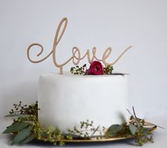This gorgeous cake topper measures 9 across and can be painted in your choice of color or left unpainted for a natural finish. Choose from gold, silver, rose gold or natural (red oak). Cut from 1/4 thick eco-friendly MDF/Wood Veneer, our cake toppers are painted on BOTH sides and sealed with a food-safe finish. Picks measure 4 apart and 3.75 long, making them an ideal size for most tiered cakes. *Color featured in first photo is rose gold. *Please note this is a delicate piece and s...
