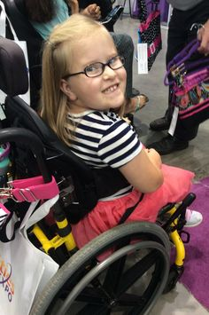 Unfortunately only the strap of her Demi-Premier Zebra Daisy Dot Pink bag made it into this picture, but that smile is so cute we just had to include this! (2015 Boston Abilities Expo)