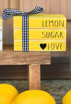 This listing is for mini LEMON SUGAR LOVE Yellow books wrapped in buffalo plaid ribbon. All other items in photo are sold in my shop separately Lemon Crafts, Wood Crafts, Diy Crafts, Book Wrap, Sugar Love, Summer Deco, Lemon Sugar, Dollar Tree Crafts, Homemade Crafts