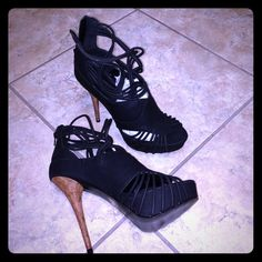"""NWOT black sexy platform sandal/shootie ⬇️⬇️reduced⬇️⬇️Sexy and hot strappy high heeled Sandal these were never worn. Great for special occasions or night on the town5""""heel with platform. Never worn brand new NWOT no box. Faux leather, wooden heel  Fahrenheit  Shoes Platforms"""
