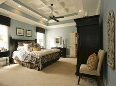 black furniture, grey-blue wall, beige floor light accents