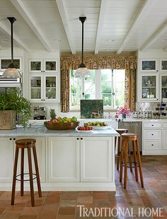 Windows and cabinet style work well together. -- Romantic Riviera-Style Home | Traditional Home