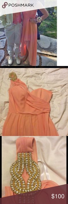 Formal/ Prom dress Peach/ coral color dress with embellished shoulder (gold and silver colored embellishments). One shoulder dress. Has padding in the top. Bottom of dress is open like a high low dress but on the side almost like a slit in the leg (see try on pic). Worn once so practically new. Size 4 from xscape. Model in pic is 5'2 and length fits her perfectly when she wore heels with it. Xscape Dresses