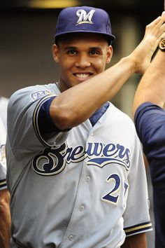 This cutie is @Adrienne Krowiorz Radtke 's way of trying to get me into baseball....  Carlos Gomez, Milwaukee Brewers