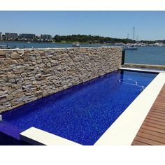 This picture depicts the beautiful weather we had in Sydney today . Loving also the dry stone wall cladding used for this blade wall and ocean blue mosaics . Both in stock in store now . Both available in a number of colors . Happy weekend.  #instadaily #instagram #followme #designers #designs #drystonewall #pool #sydney #woollahra #bondi #cerastonetiles #cerastone #luxurylife #architecture #architectureporn #architecturelovers #architect #interiordesign #interior #interiors #poolside #glassmosaic #mosaics #blue #tileporn #instalike #stone #landscaping #wallcladding #sunnyday Sydney Today, Blue Mosaic, Mosaic Glass, Stone Landscaping, Dry Stone, Wall Cladding, Happy Weekend, Pool Ideas, Swimming Pools