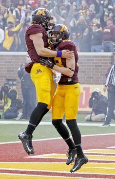 Minnesota quarterback Philip Nelson, left, and wide receiver Derrick Engel, right, celebrate Engel's touchdown. (Ann Heisenfelt/AP)