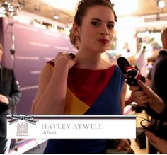 Actress, Hayley Atwell talking to us about her views on everyone wearing dark colours in the winter, well she sure is a vision in red, blue and yellow! ©FranklynLane