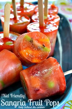 Kid Friendly Sangria Fruit Pops ~T~ Grape juice, strawberries, mango, kiwi, green grapes, lime juice, lemon lime soda and water. Kids will love these.
