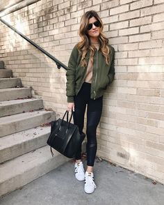 Green army jacket / Adidas sneakers / blue jeans / shirt