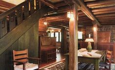 "The interior of Stickley's own Craftsman Farms house in New Jersey, with its incredible copper fireplace hood, its delicately inlaid piano and its subtle ""S"" carved into the spindleboards of the staircase"