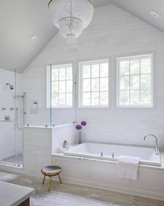 Gorgeous space was designed by Nicole Forina Home featuring the Jacqueline chandelier by Visual Comfort & Co. Bathroom Remodel Cost, Master Bath Remodel, Bathroom Makeovers, Bathroom Renos, Bathroom Interior, White Bathroom, Master Suite Bathroom, Bathroom Windows, Bathroom Ideas