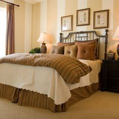 Elegant stripes on the walls and bed covers add warmth to this room