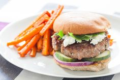 Harissa-Spiced Lamb Burger with Roasted Carrot Fries Recipe Main Dishes with garlic, whole wheat hamburger buns, white wine vinegar, mint, kirby cucumbers, carrots, purple onion, mediterranean seasoning mix, ground beef, whole wheat breadcrumbs, arugula, feta cheese, harissa paste