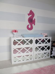 Materials: Two Aneboda chest of drawers, Ballard Designs Fretwork panels, cut- to-order mirrorsDescription: I love the look of mirrored fretwork furniture and had always wanted to attempt an Ikea hack. I needed a place to change my baby and store her clothes. When I came across the Aneboda drawers for about $59 each, I thought …