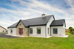 County Mayo bungalow with tricky planning permission Dormer House, Dormer Bungalow, Modern Bungalow House, Bungalow Exterior, Bungalow Renovation, Bungalow House Plans, Cottage House Plans, Bungalow Designs, Bungalow Ideas