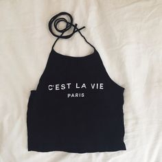 Brandy Melville Halter C'est La Vie Brandy Melville Halter. Worn one time, no flaws, like new. One size. Price firm Brandy Melville Tops Tank Tops