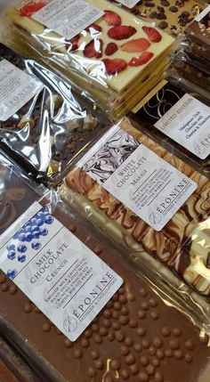 A selection of our chocolate Artisan Bars paparazzi'd this weekend, including Milk Crunch, Ginger & Cocoa Nib, Marble, Strawberries & Cream - available in our online boutique here : http://eponinepatisserie.co.uk/product-category/chocolate-bars/  (Photograph taken by Frodsham Independent Market) (Eponine Patisserie & Chocolaterie)