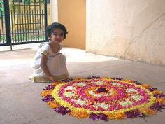 Kid and Onam Pookalam