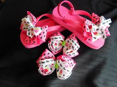 The perfect accessory for the summer.   I love Watermelon bow flip flops, we're made with 1.5in. Hot Pink grosgrain watermelon seeds ribbon, 7/8 in. grosgrain printed watermelons with 4 loppers of ants printed on 3/8 grosgrain ribbon on pink flip flops. Matching piggy tail bows Size is 7-8.These bows measure approx. 3-3.5 in. across. All ribbon has been heat sealed, glued and tied to the flip flop. (The ribbon is not water proof)  Set will be $15.00 with free shipping