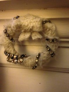 Up cycled jewelry made into wreath ornament.