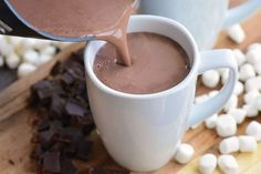 The BEST Homemade Hot Chocolate recipe. This is a rich, smooth, and creamy hot chocolate made with bittersweet chocolate, cocoa powder, milk, and a splash of vanilla extract. #drink #hotchocolate #chocolate #hotcocoa #hotdrink Hot Chocolate With Cocoa Powder, Nutella Hot Chocolate, Hot Cocoa Mixes, Creamy Hot Chocolate Recipe, Homemade Hot Chocolate, Hot Chocolate Recipes, Hot Buttered Rum, Drinks Alcohol Recipes, Unsweetened Cocoa