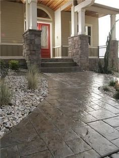 Stamped concrete walkway and front porch. Love the masonry on the pillars. by Hercio Dias #deckbuildingconcretepatios