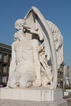 The Kiss of Death - 1930s sculpture in a Barcelona cemetery