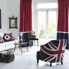 Union Jack covered chair and scatter cusions - love that the drapes complement the patriotic theme of the space #unionjack #flag