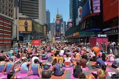 Solstice In Times Square: Mind Over Madness Yoga. Each year, thousands of yogis from around the world travel to Times Square to celebrate the Summer Solstice in the heart of New York City. Photo credit: Kevin Gregor from Bikram Yoga NYC