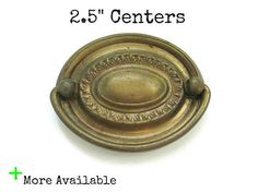 This listing is for 1 vintage ornate drawer pull with both screws -Nice worn brass colored metal patina, some minor rust and wear -Measurements: Just under 3 1/8 wide, 2.5 tall, 2.5 centers (from the center of one screw hole to the center of the other) Check out the hardware sections of my store for more pull and knob options.  See more ornate and French Provincial pulls here: https://www.etsy.com/shop/Fairyhome?section_id=8156245&ref=shopsection_leftnav...