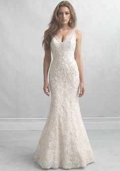 Style MJ15 by Madison James. A mermaid silhouette with scalloped beaded lace. l TheKnot.com