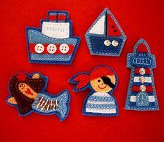 nautical felt pirate, sailboat, lighthouse, mermaid, and tug boat.