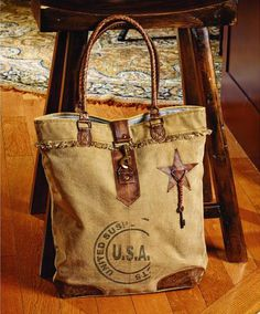 USA Canvas Bag from Country Village Shoppe. http://www.countryvillageshoppe.com/U-S-A-canvas-bag-purse-16x16x4. See more country products in the May issue of Country Sampler: https://www.samplermagazines.com/detail.html?prod_id=159&source=pin