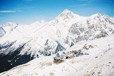 Landscape winter panorama of the mountain with ski slopes. The concept of a vacation is snowboarding and skiing, enjoying the alpine mountain scenery. Alpine Mountain, Winter Mountain, Mountain Landscape, Winter Landscape, Snowboarding, Skiing, Ski Slopes, Mount Everest, Scenery