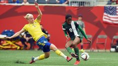Nigeria's forward Asisat Oshoala kicks the ball to score a goal as Sweden's defender Nilla Fischer tries to stop during Group D match of the 2015 FIFA Women's World Cup between Nigeria and Sweden at the Winnipeg Stadium on June 8, 2015, in Winnipeg, Manitoba. AFP PHOTO/JEWEL SAMAD