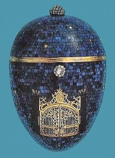 The Twilight Egg (or The Night Egg), other Eggs, lapis lazuli, gold, diamonds, moonstone, paillons, enamel, carving, 1917. The back of the egg is set with a lapis lazuli Romanov Eagle, carved in relief above the date, 1917, inlaid in engraved gold, it was possibly made for a member of the Imperial Family. Private Collection