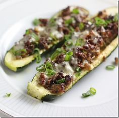 Zucchini stuffed with ground beef and cheese -- quick and easy low carb lunch or dinner. I think I could actually make this =) Need to really cut my carbs!!