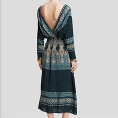 NWT free people she's a lady Beautiful boho gown with an intricate detailed print! Looks beautiful with a pair of Cognac wedges size small Free People Dresses Maxi